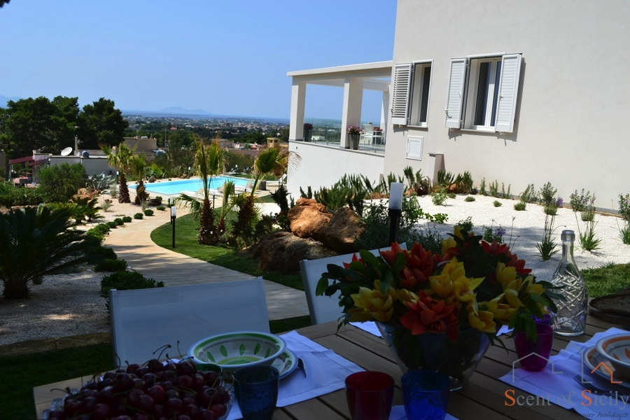 Eating outside with wonderful view in the luxury Villa Kalon Marsala Scent of Sicily
