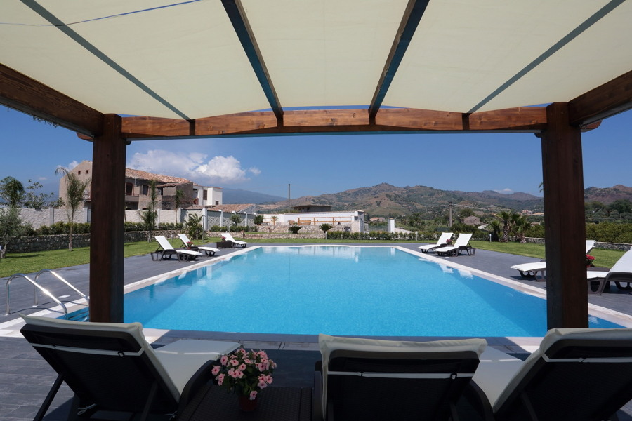 Villa Phoenix, Giardini Naxox, Taormina, Sicily, view of the pool from the pation