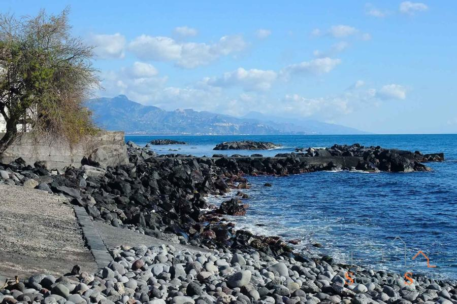 Private access to the rocky bay and sea from Sea Terrace, Torre Archirafi Eastern Sicily
