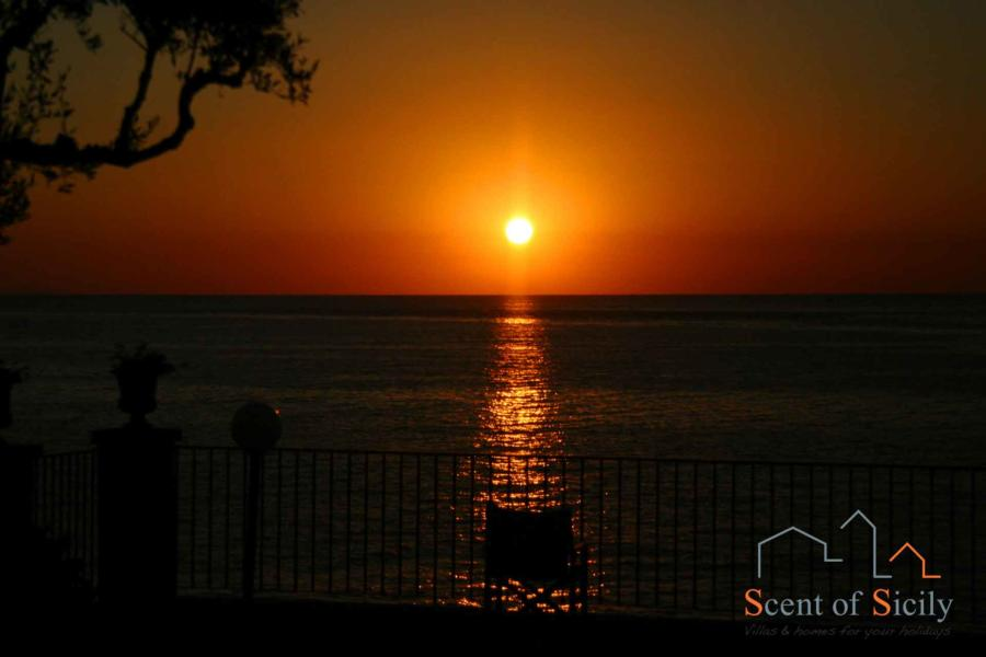 Sunset from Sea Terrace garden Torre Archirafi, Estern Sicily