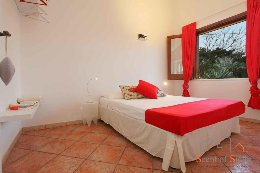 Red double bedroom in Villa Lory, Marsala Western Sicily - main house