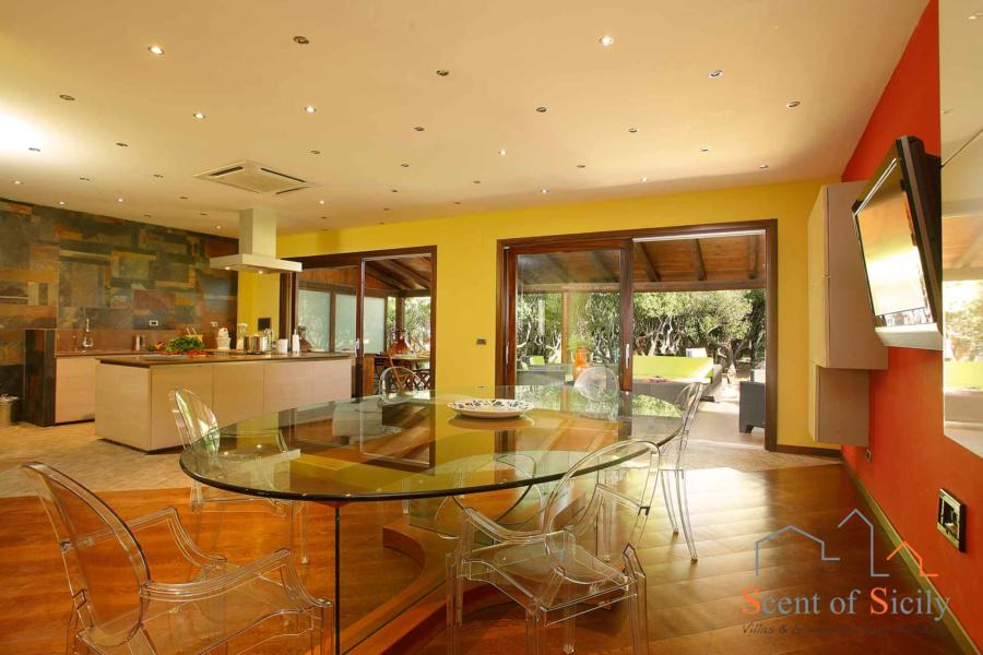 On the ground floor you will find a beautiful kitchen and big dining table...
