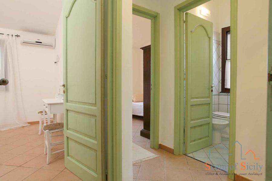 To the sleeping area in mainhouse  of Villa Gio, Marsala, Western Sicily