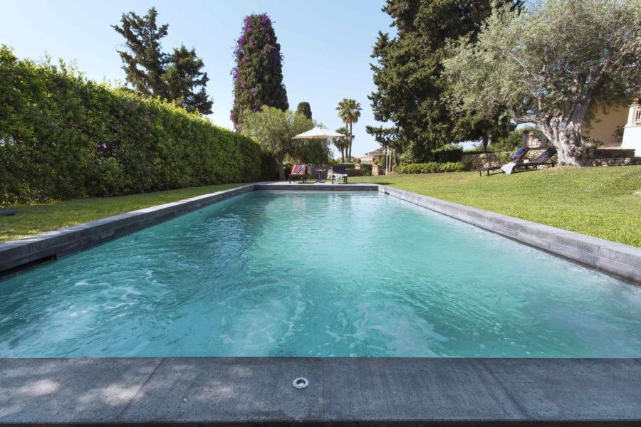 The lava stone pool in Villa Shanti Syracuse Scent of Sicily
