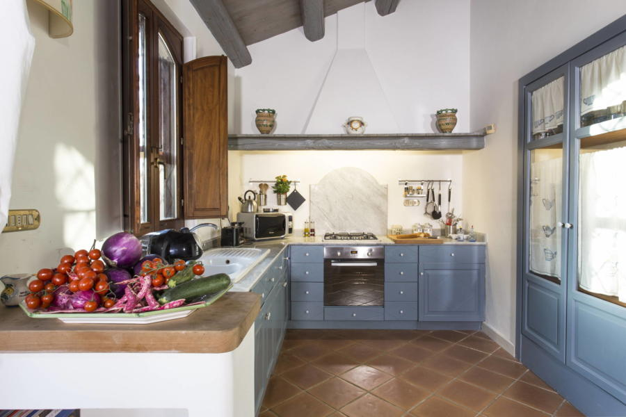 The kitchen overlooking the patio and the pool area inn Casale dell'Ulivo Syracuse Scent of Sicily
