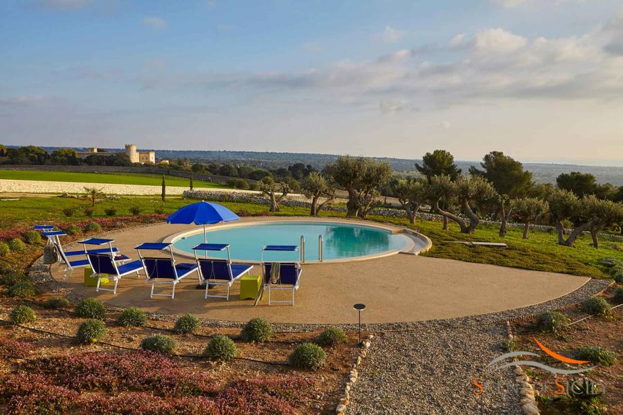 Villa Bianca, Donnafugata, Sicily - View of the castel form the circular infinity pool