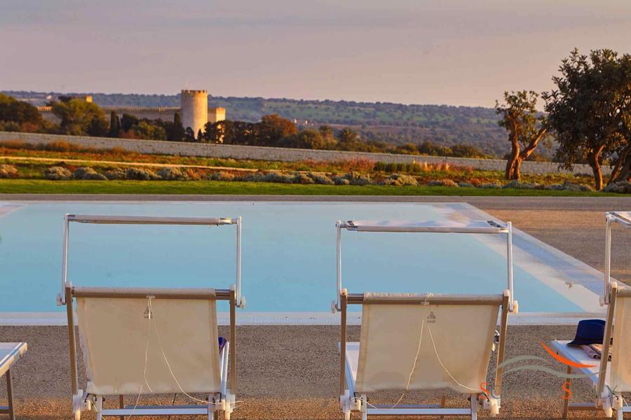 Villa Bianca, Donnafugata, Sicily - View of the castel form the rectangular infinity pool