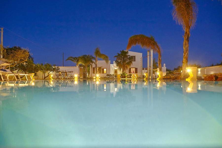 Enjoy the warm evenings from the pool from Villa del Tufo Marsala Scent of Sicily