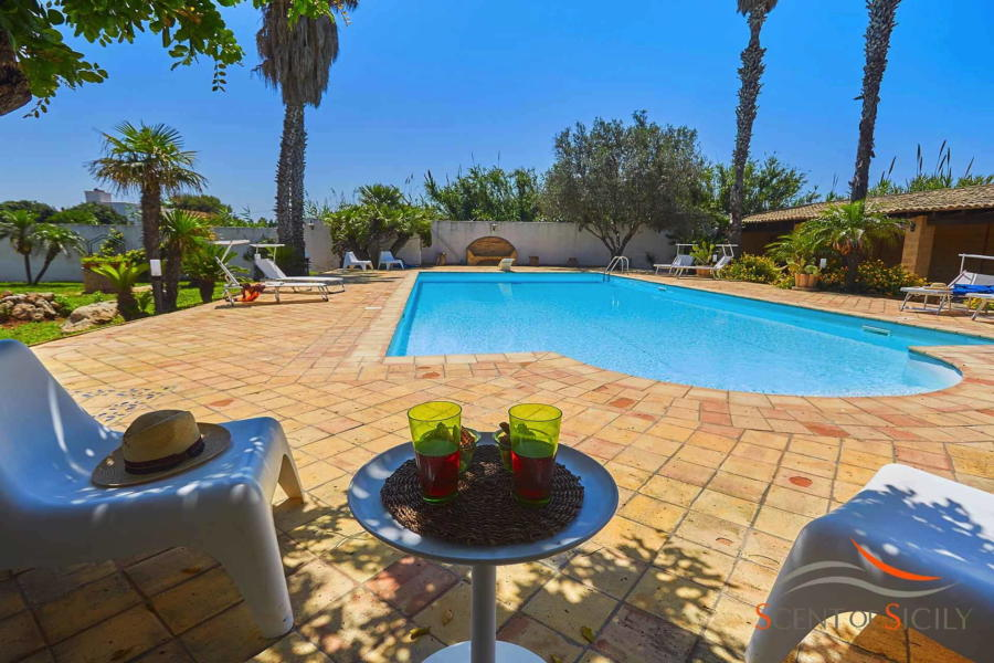 Relax area in the pool of Villa Lory, Marsala Western Sicily