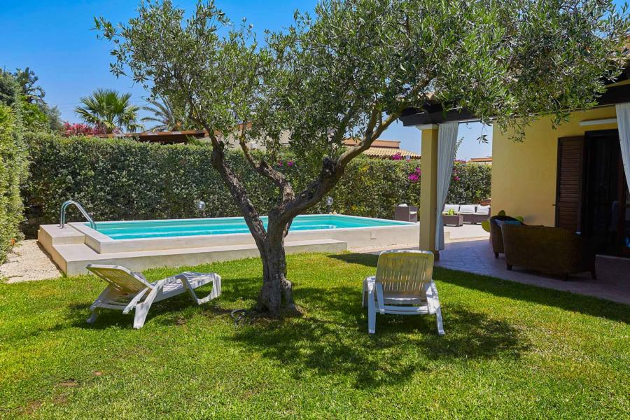 Villa Simo Marsala Western Sicily,  relax under the olive tree in front of the pool