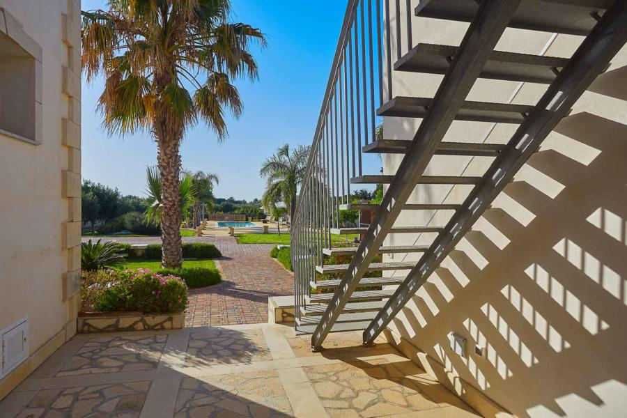 Staircase will take you to one double bedroom in Villa del Tufo Marsala Western Sicily Scent of Sicily