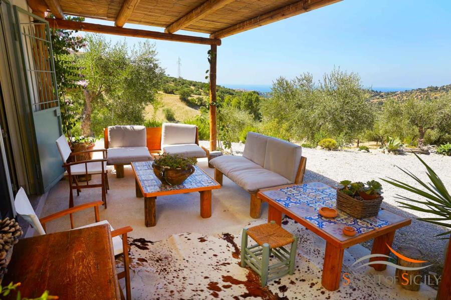 Comfortable sofa in the patio with a wonderful view in Villa Marina Scent of Sicily