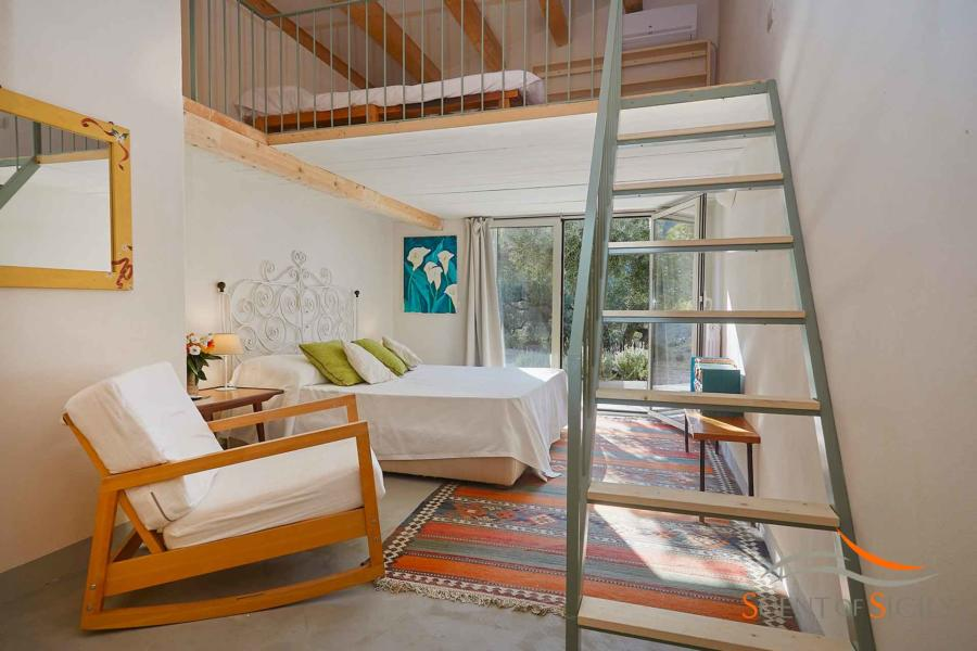 A staircase will take you to the loft where you will find a double bed in Villa Marina Scent of Sicily