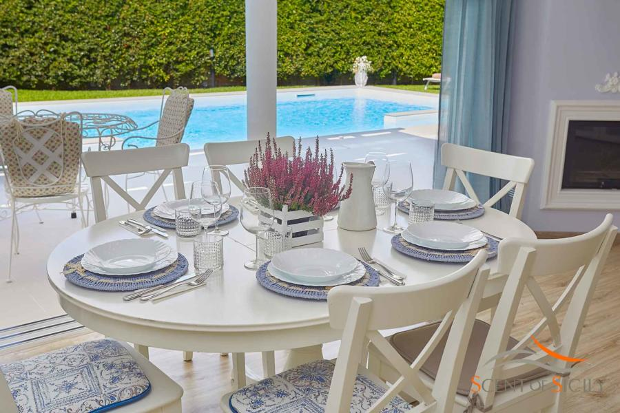 Enjoy each other's company while sitting around this table in Villa Taormina Bellevue Taormina Scent of Sicily