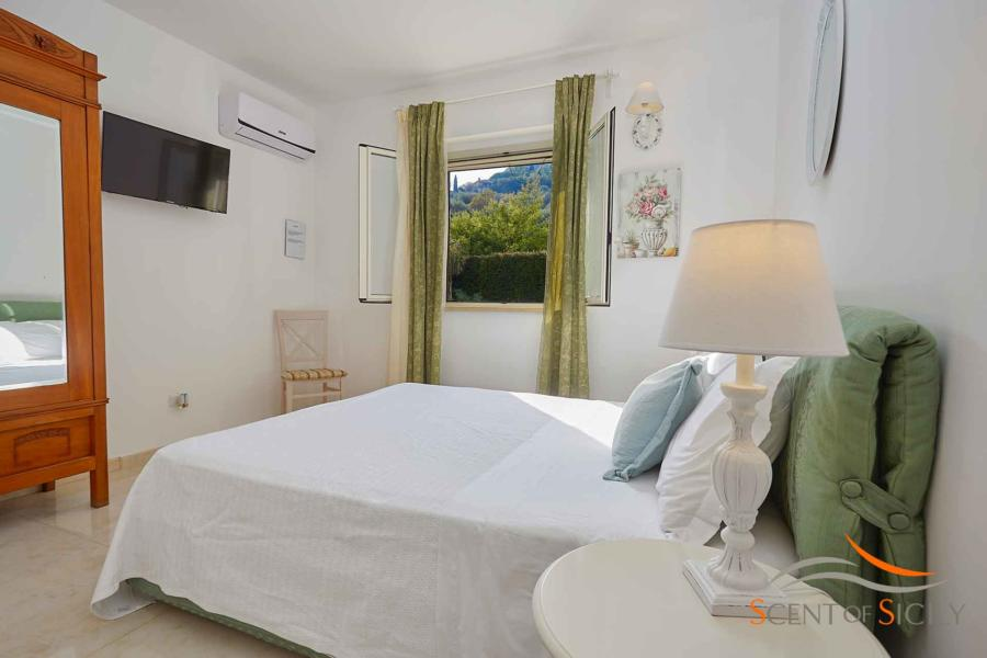 Elegant double bedroom with window view in Villa Taormina Bellevue Taormina Scent of Sicily