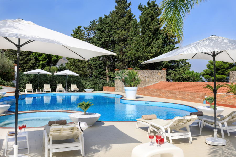 Large swimming pool with jacuzzy area in Villa Amphora Carini Scent of Sicily