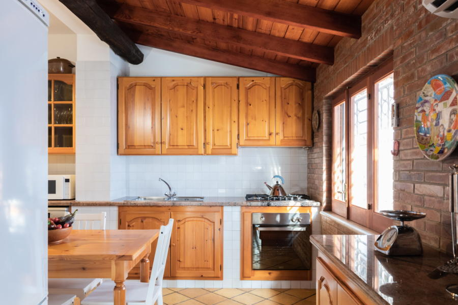 Well equipped kitchen with dining table in Villa Amphora Carini Scent of Sicily