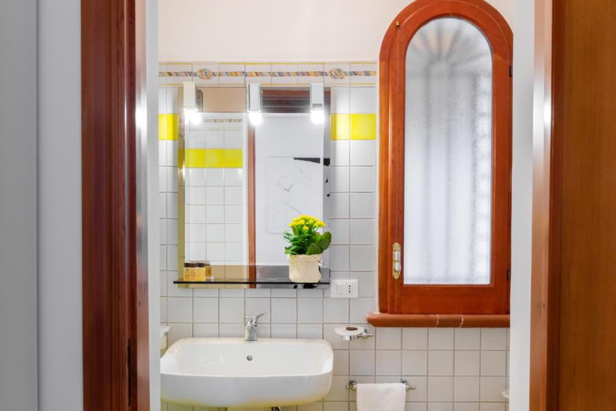 Yellow bathroom in Villa Amphora Carini Scent of Sicily