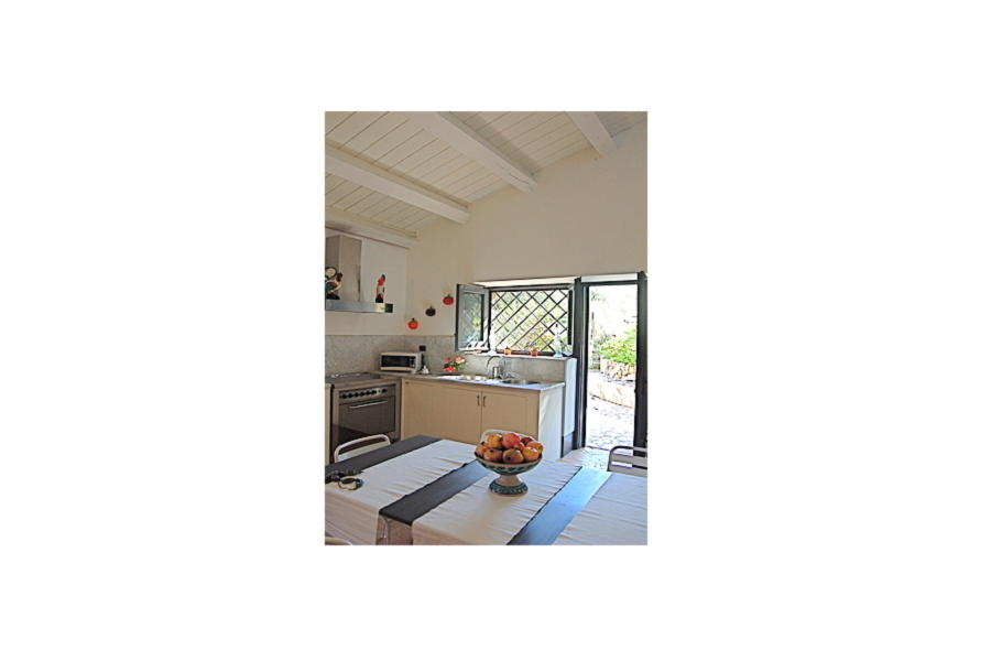 The kitchen of the house with loft in Villa Sea View Cefalu area Scent of Sicily