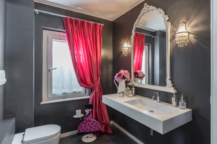 A nice detail of a pink bathroom.