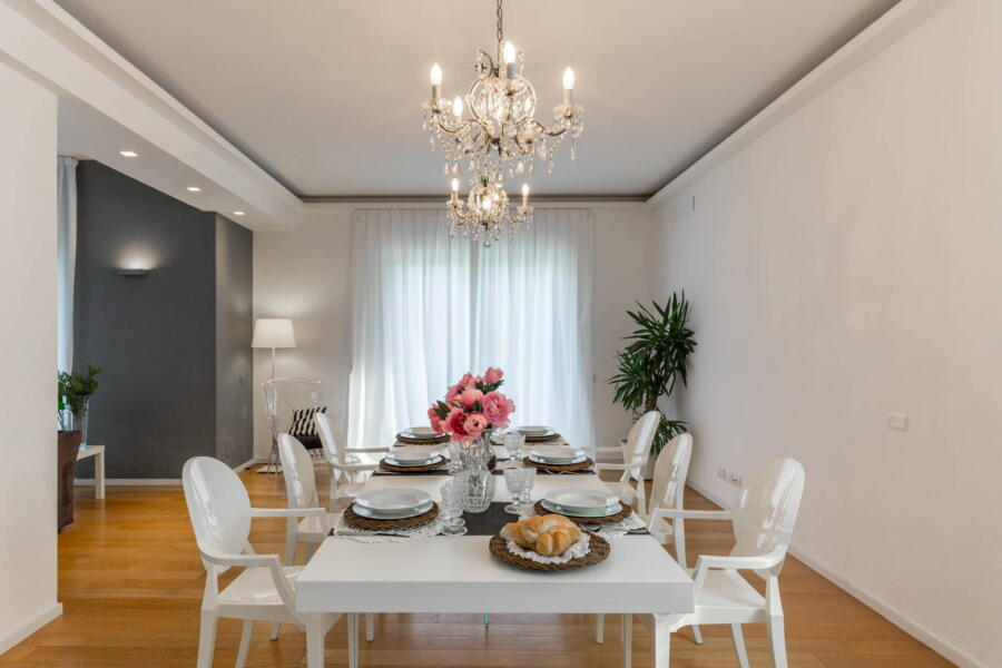 The refined white elements of the dining room.