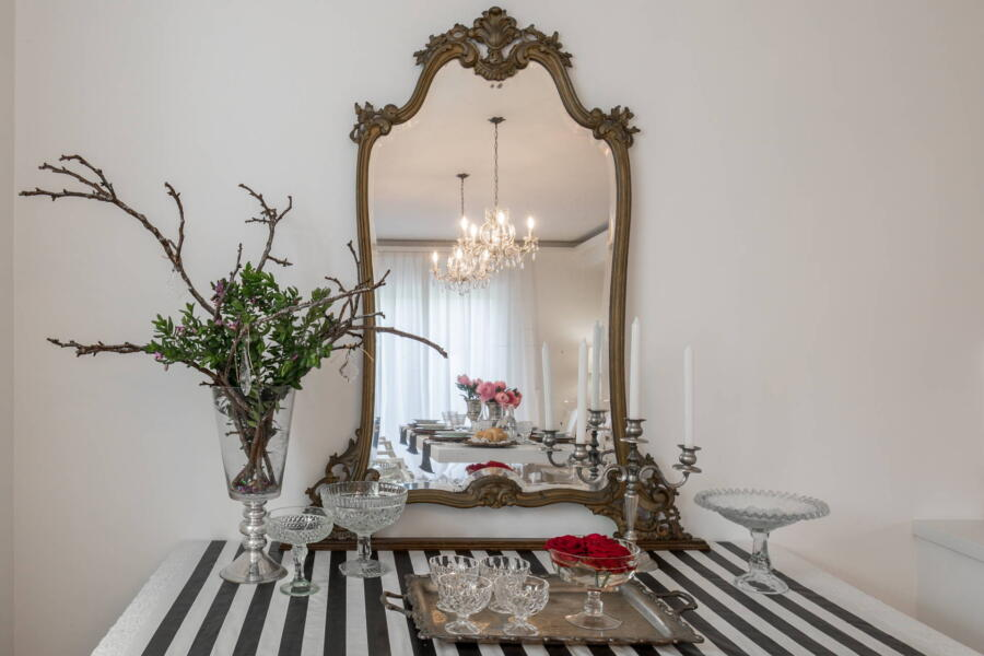 The dining room reflected in the ancient mirror.