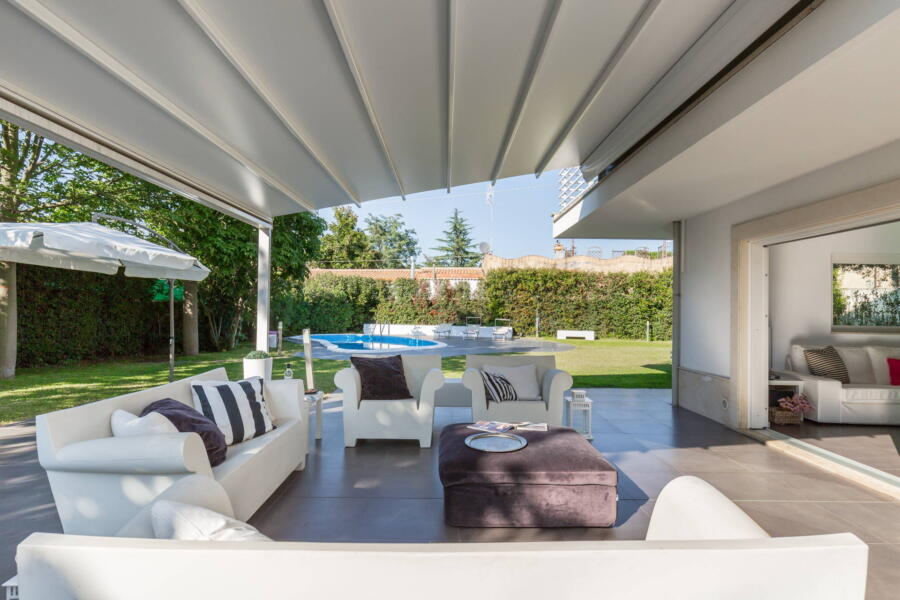 Relax on a sofa in the patio.