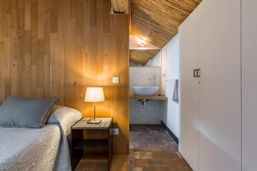 The harmonious bedroom en-suite in the loft