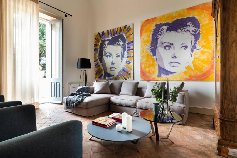 In the refined living room of the villa is a portrait of one of the most famous actresses in the history of cinema