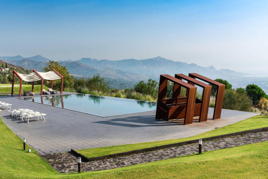 Geometric shapes and nature meet in the pool area