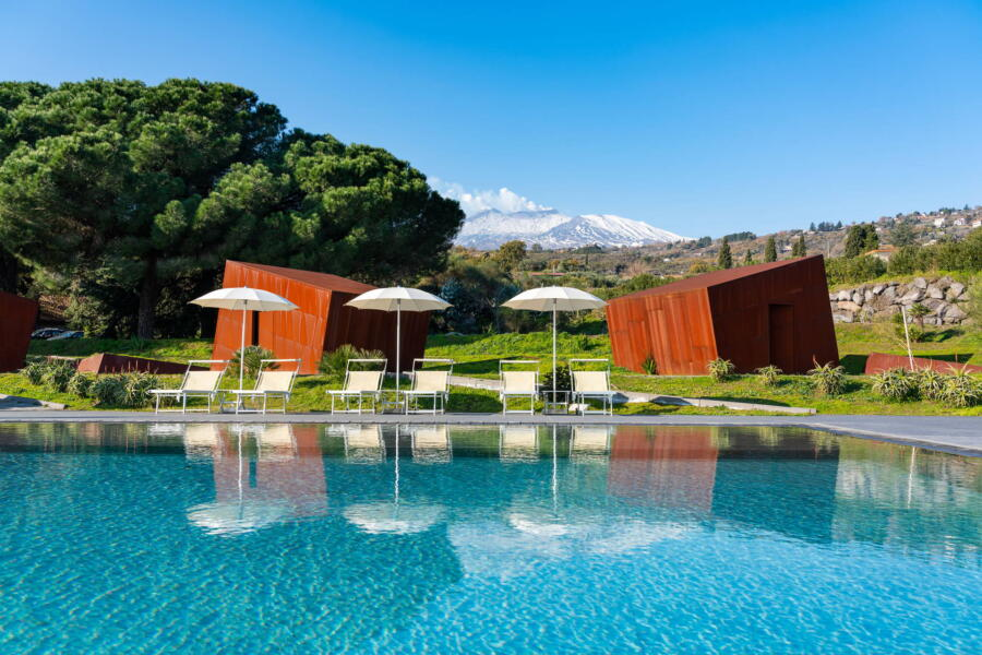 Behind the pool is the magical Etna