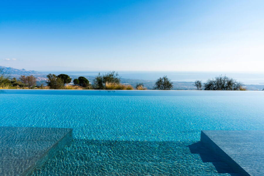 The view of the blue sea from the pool