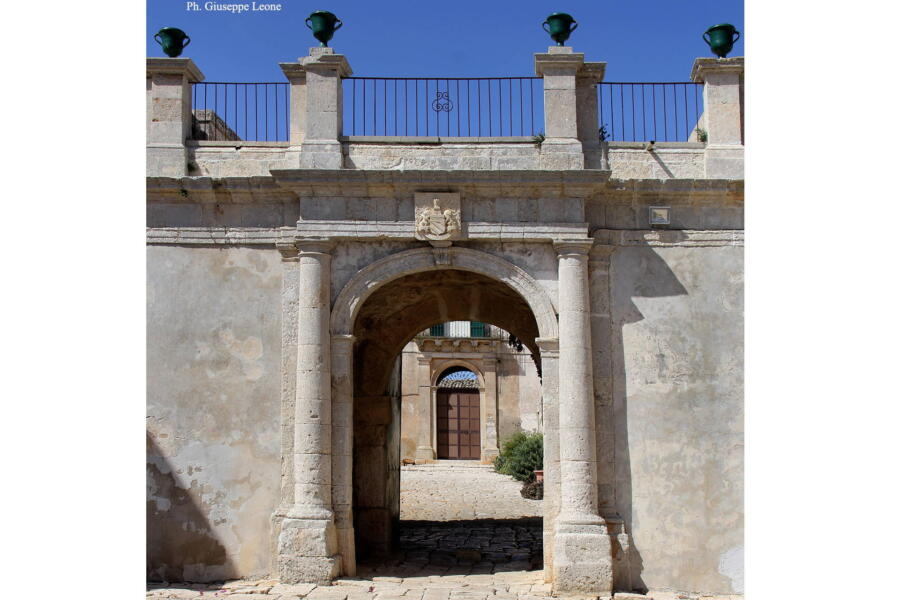 The arch that welcomes you to the courtyard with the main door.