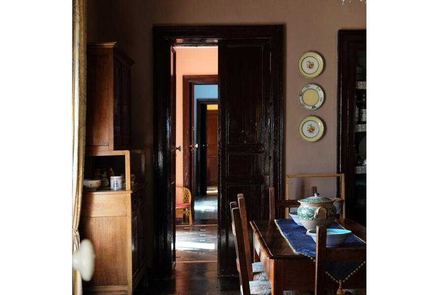 The dining room, and the door that introduces a three communicating bedrooms, which overlook the beautiful countryside of baroque Sicily