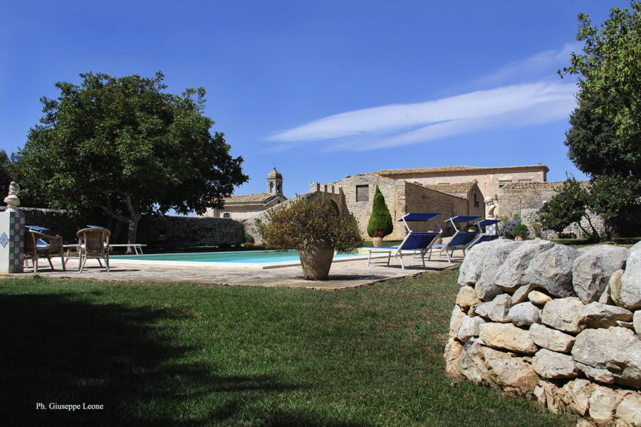 View from the green of the pool in this charming historic residence.