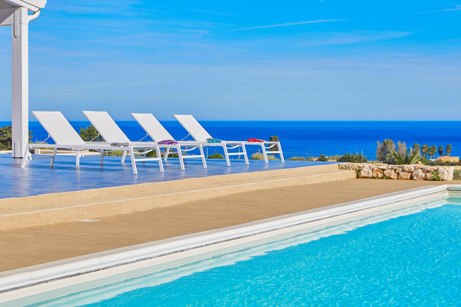 Relaxing by the pool surrounded by shades of blue