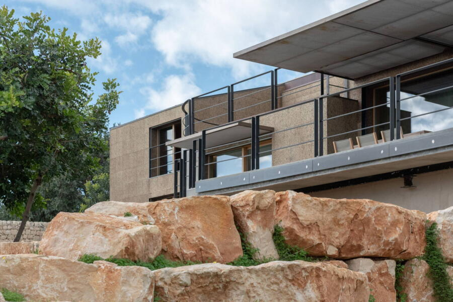 the architectural lines of the villa blend harmoniously with the nature