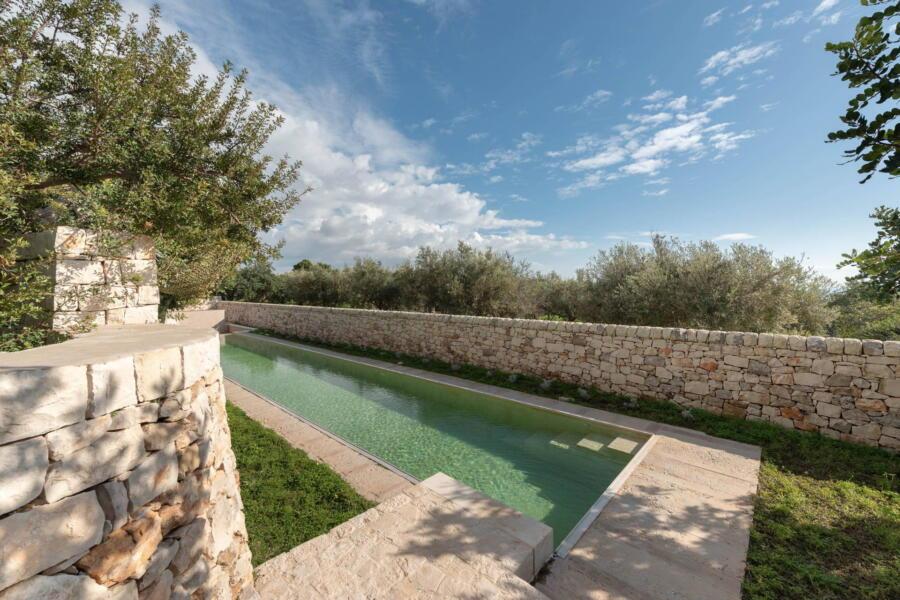 A comfortable swim in the villa's bio pool