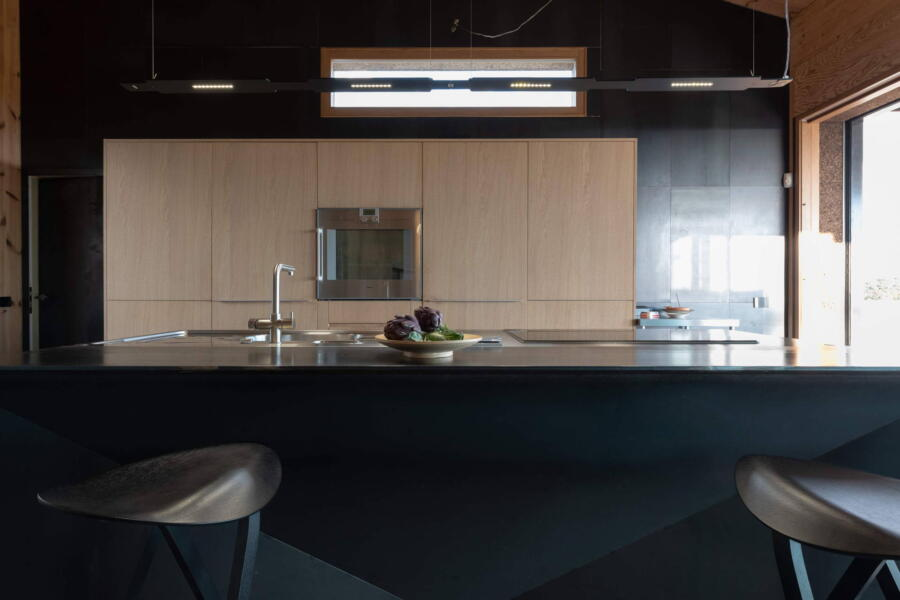 Eating on designer stools at the kitchen island counter
