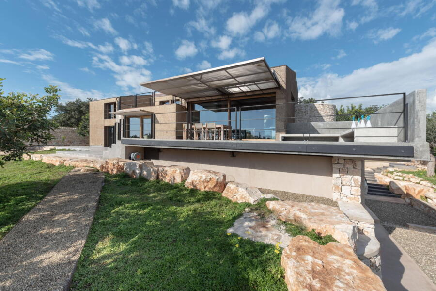 The architectural lines of the villa blend harmoniously with its surroundings