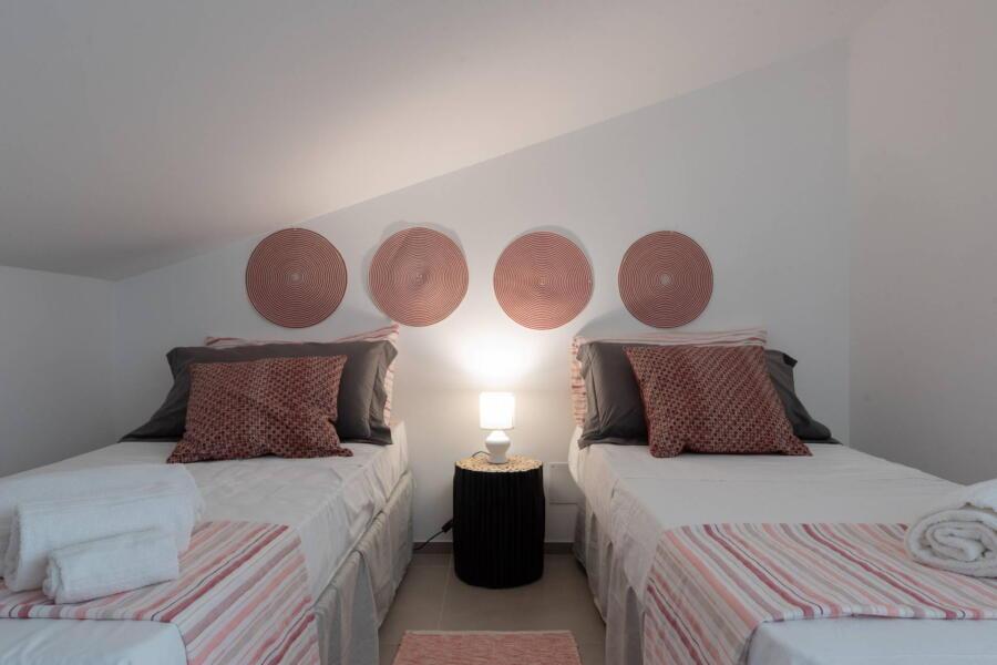 Twin bedroom red spirals
