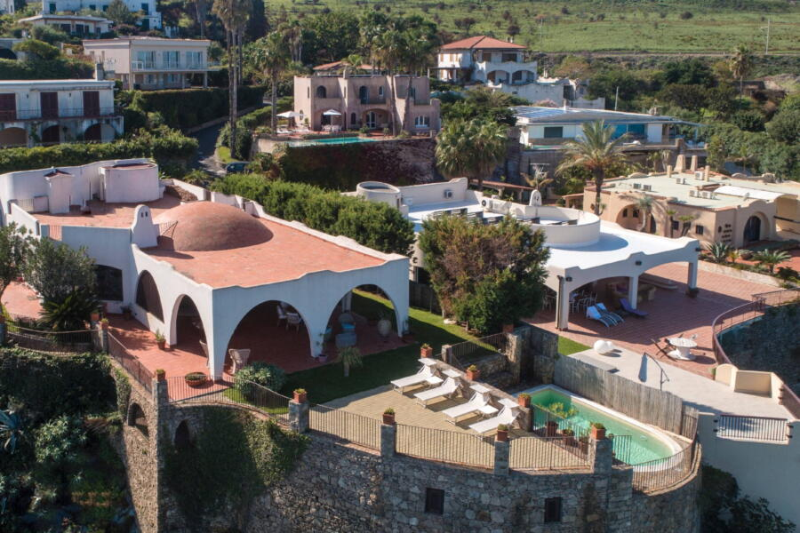 The villa and its patio photographed from the air