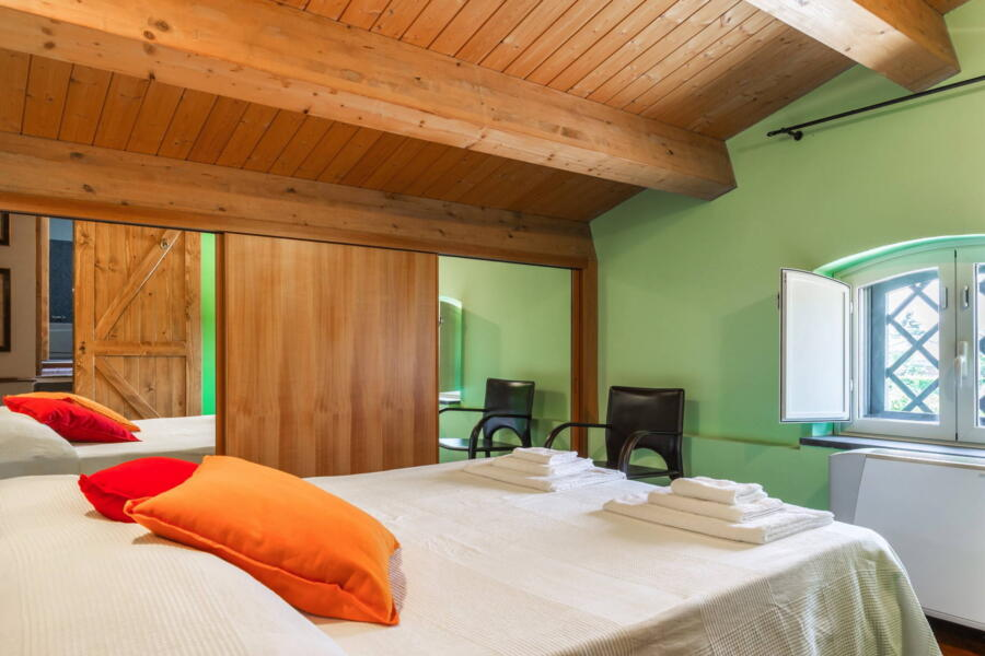 The green bedroom with its beamed ceiling