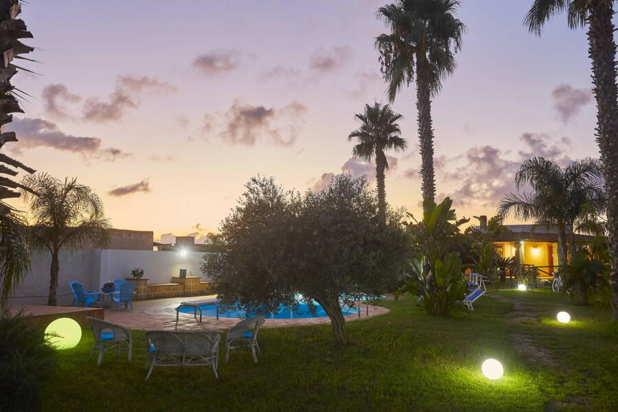 Pool area in the sunset of Villa Gio, Marsala, Western Sicily