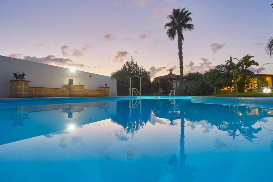 Sunset in the pool of Villa Gio, Marsala, Western Sicily