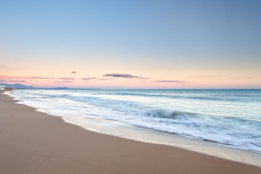 Sunset at the sandy beach near villa Gio