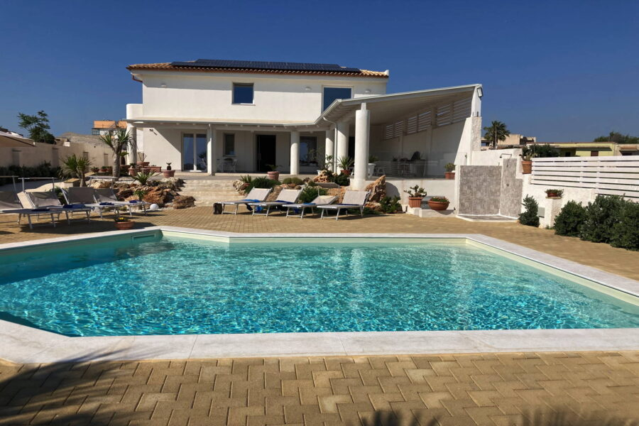 The view of the villa from the blue waters of the pool