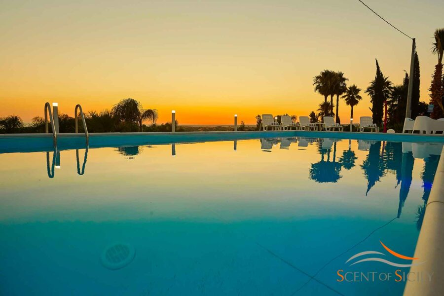 Enjoy the magical colours of the sunset from the swimming pool